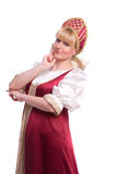 Woman in Russian traditional costume. Girl standing in Russian traditional costume. Woman is wearing sarafan and kokoshnik . The girl in red old russian dress stock photography