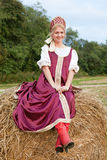 Woman in Russian traditional costume. Is lying on the haystack royalty free stock images