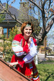 Woman in Russian traditional costume. Fiftieth woman in Russian national dress on the background of the house in the early spring stock images