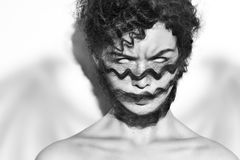 Woman& x27; s面孔以在眼睛的恐惧 库存照片