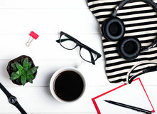 Woman`s accessories and coffee on the white wooden table, Stock Image