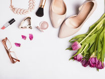Woman`s accessories and cosmetics on the white background Stock Image