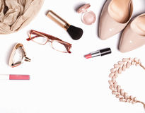 Woman`s accessories and cosmetics on the white background Royalty Free Stock Image
