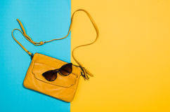 Woman`s accessories flat lay on colorful background top view. Woman`s accessories flat lay on colorful background. Top view Blue and yellow pastel colors with Royalty Free Stock Photography
