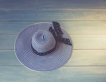 Woman`s accessories seen from above, top view. Concept image. Women`s hat on wooden Royalty Free Stock Image
