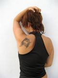 Woman's back. Young woman's back with brown short hair and arm on her head Stock Images