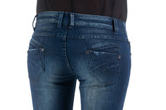 Woman's back. In blue jeans Stock Image
