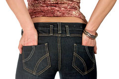 Woman's back. Hands in blue jeans pockets Stock Photo