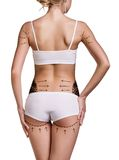 Woman's back. Woman's buttocks prepared to plastic surgery isolated Stock Photos