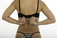 Woman's back holding bra straps Royalty Free Stock Photos