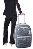 Woman's back with a suitcase Royalty Free Stock Photo