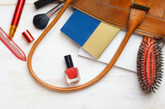 Woman`s bag and it`s content Stock Images