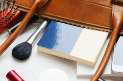 Woman`s bag and it`s content Royalty Free Stock Photo