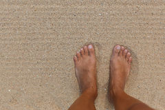 Woman's Bare Feet on the beach. Stock Photo