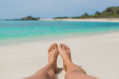 Woman's Bare Feet on the beach. Royalty Free Stock Photography