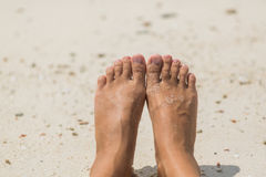 Woman's Bare Feet on the beach. Stock Image