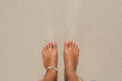 Woman's Bare Feet on the beach. Stock Photography