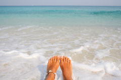 Woman's Bare Feet on the beach. Royalty Free Stock Photos