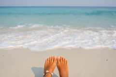 Woman's Bare Feet on the beach. Royalty Free Stock Image