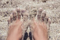 Free Woman`s Bare Feet Covered With Sand On The Beach. Stock Photos - 101877933