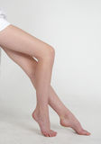 Woman's Bare Legs Stock Images