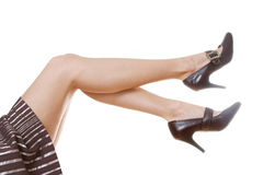 Woman's beautiful legs. In brown striped skirt Stock Photos