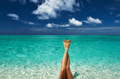 Woman's legs at beach Royalty Free Stock Image