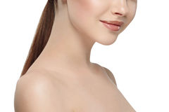 Woman's beautiful part of the face nose lips chin and shoulders, healthy skin and her on a back close up portrait studio on white Stock Photography