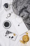 Woman`s bed top view on a lazy sunday morning in cold weather . Lifestyle with mobile phone, book, cakes Stock Photography