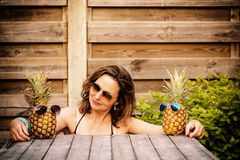 A woman`s best friends are pineappels Stock Images
