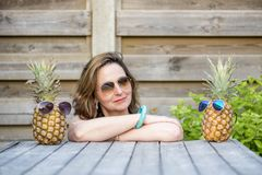 A woman`s best friends are pineappels Stock Photos