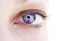 A woman's blue eye with mascara Royalty Free Stock Photos