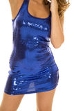 Woman's body in blue shiny dress front Stock Image