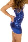 Woman's body in blue shiny dress side Stock Image