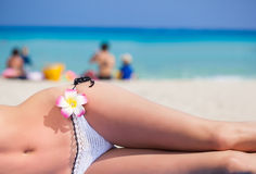 Woman's body is lying on the beach Stock Images