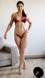 Woman`s body to competition fitness bikini. Royalty Free Stock Images