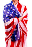 Woman`s body wrapped in the USA national flag Stock Image