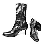Woman's boots. A pair of shiny black woman's boots Stock Images