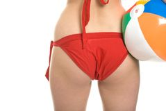 Woman's bottom in bikini holding beach ball Royalty Free Stock Photos
