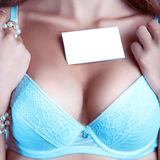 Woman's breast in a bra with empty name tag Stock Photo