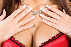 Woman's breasts and neck with a necklace Royalty Free Stock Image