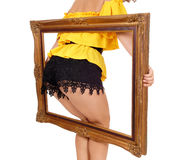 Woman's butt in picture frame. Royalty Free Stock Photo