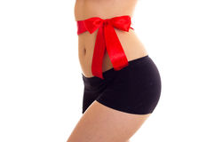 Woman`s buttocks with red bowtie Stock Photos