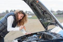 Woman 's car breaks down Stock Photos
