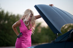 The woman's car broke down Stock Photography