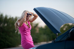 The woman's car broke down Stock Images