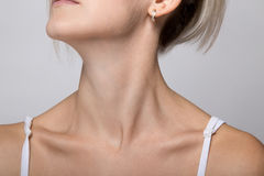Woman`s chin and neck. On gray background royalty free stock image