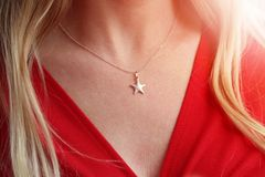 A woman`s cleavage with a star shaped necklace Stock Photography