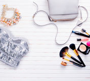 Woman's clothing and accessories on a wooden background. Woman's clothing and accessories placed on a wooden background Royalty Free Stock Photo