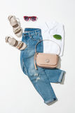 Woman`s clothing set. Full female look, sandals, jeans, handbag, shirt on white background Stock Photos